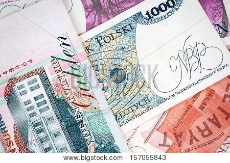 Old Polish invalid banknotes as a background poster