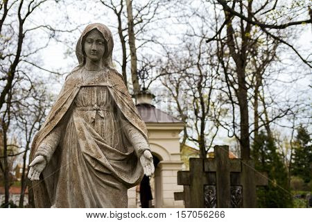 Statue of Virgin Mary at Rasu cemetery in Vilnius Lithuania