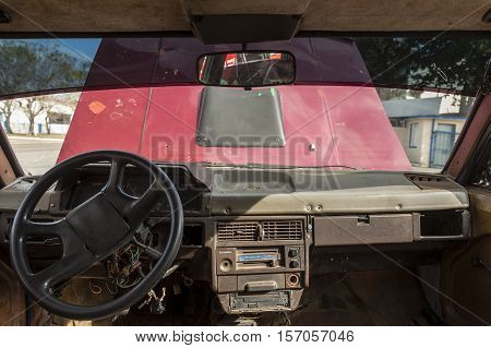 Broken down old vintage taxi with open hood in Cuba