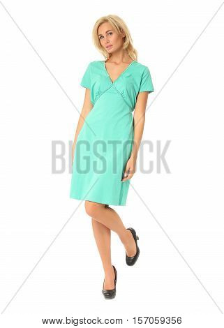 Full Length Of Flirtatious Woman In Turquoise Dress Isolated On White