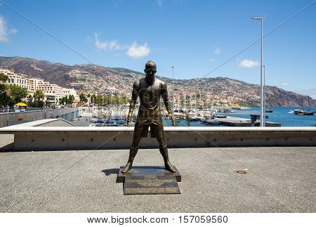 FUNCHAL, MADEIRA, PORTUGAL - SEPTEMBER 1, 2016: The statue Christiano Ronaldo before the entry to the Museum CR 7 in Funchal on Madeira. Portugal