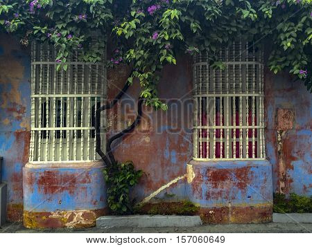 House Window With Wooden Bars In Cartagena, Colombia