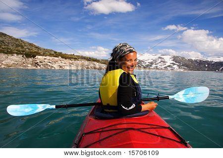 Kayak at glacier lake, Styggevatnet, Jostedalsbreen in Norway.Summer. poster