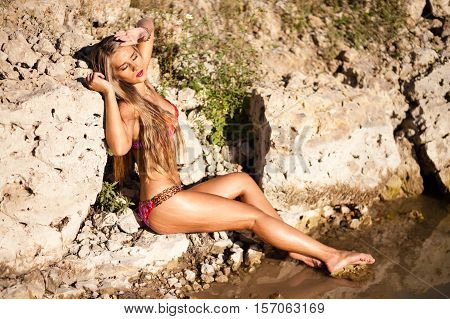 Long hair girl in bikini on river.