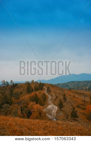 Mountain road in the autumn day in Altay, Siberia, Russia