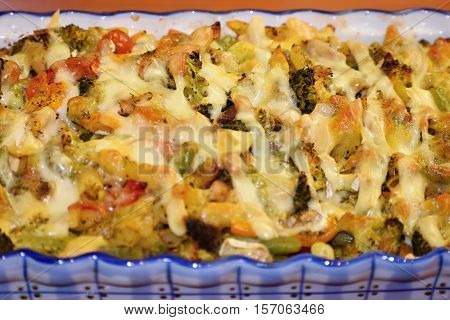 Baked pasta with ham and cheesy. Good food.