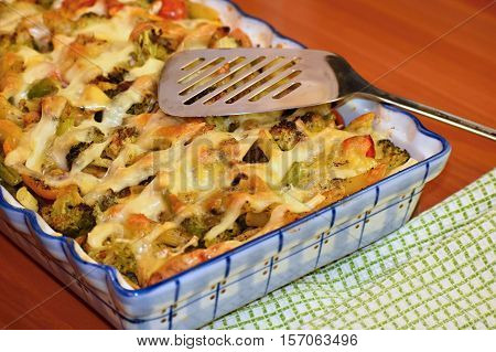 Baked pasta with ham, vegetables and cheesy