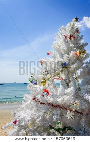 Ao Nang beach, Thailand - December 25 2012: Christmas tree in front of Ao Nang beach on Christmas Day in Krabi Province, southern Thailand