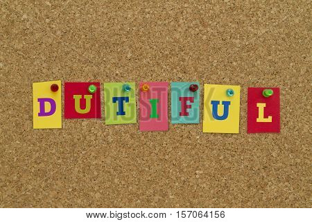 Dutiful word written on colorful sticky notes pinned on cork board.