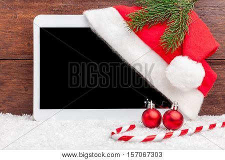 Christmas Decoration And A Tablet With Copy Space
