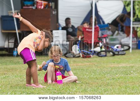 Girls Blowing Bubbles At The Wild Goose Festival