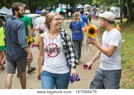 Man Giving Woman Flower As A Peace Gesture