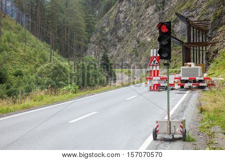 Temporary traffic light on a mountain road
