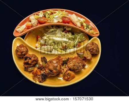 Meatball and salad . Healthy food on original plate