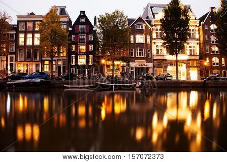AMSTERDAM, NETHERLANDS - OCTOBER 24, 2016: Beautiful views of the streets, ancient buildings, people, embankments of Amsterdam - also call