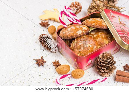 Christmas cookies with almond nuts and ginger in tin box holiday concept
