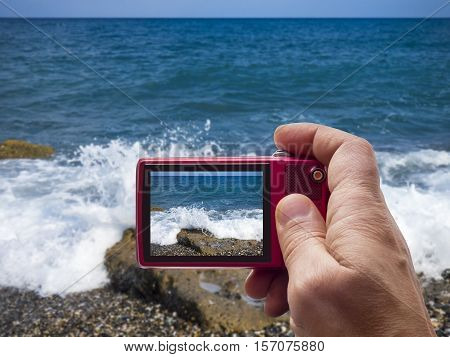 Sunny beach at Sicily in camera viewfinder