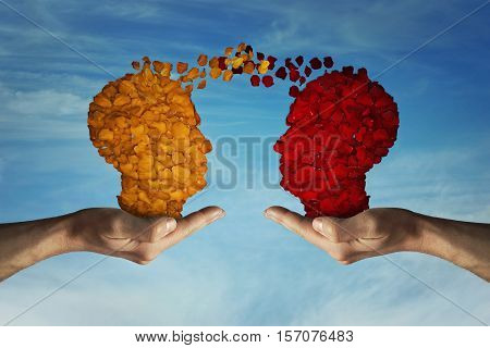 Two hands holding rose petal heads on blue sky background. Romantic relationship concept. Attachment and love symbol giving and exchange of feelings and emotions. Thinking exchange and idea partnership business.