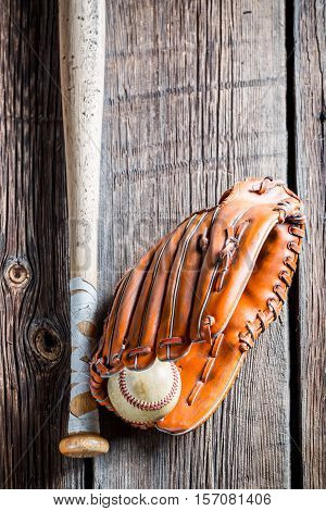 Vintage Baseball Glove And Ball On Old Wooden Table