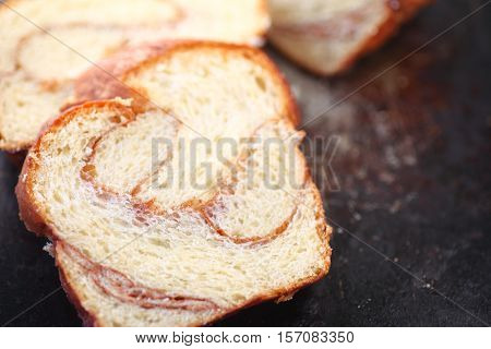 Slice of cinnamon-swirled brioche with copy space