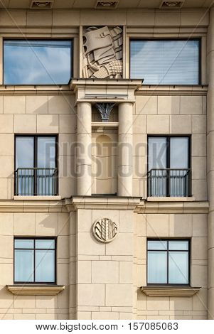 The image of Windows on a background of beige wall on the facade with columns and moldings. From the series window of Saint-Petersburg.
