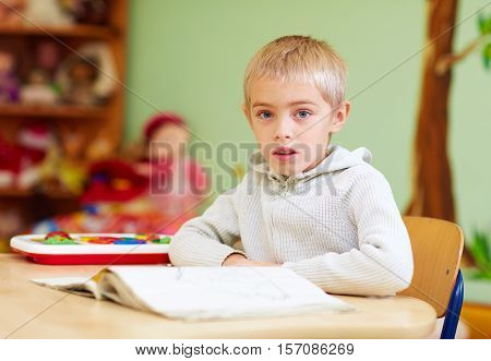 Cute Boy, Kid With Special Needs Learning In Rehabilitation Center