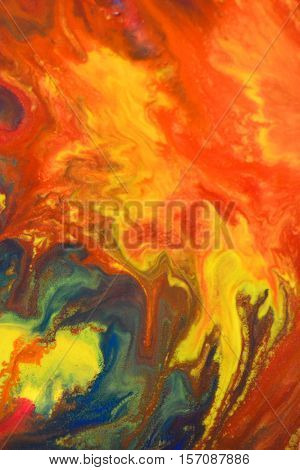 Red, green, blue, yellow fluid chaotic mix of colors macro. Abstract color creative art background basis closeup.