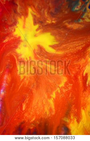 Red yellow fluid chaotic mix of colors macro. Abstract color creative art background basis closeup.
