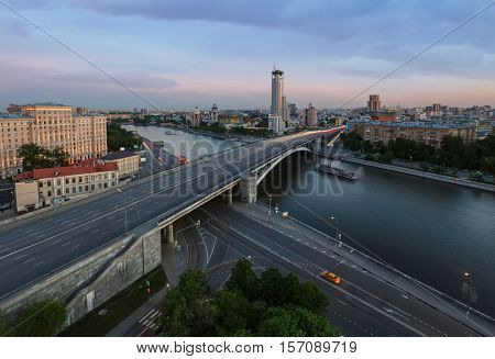 Big Bridge Krasnokholmsky, ship on river, evening quay in Moscow, Russia