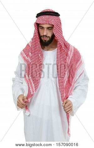 Young disappointed Arab with a checkered veiland holding his head isolated on white background