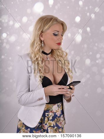 Young girl with mobile phone on abstract background