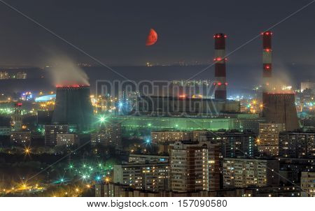 Territory of power plant and residential aera at summer moon night in Moscow, Russia