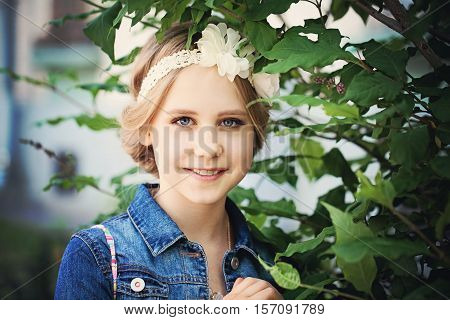Young beautiful Girl with light hair Outdoors