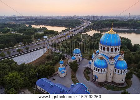 Temple of Holy Trinity, highway and panorama of Moscow, Russia at morning
