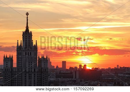 Stalin skyscraper and panorama of city during sunrise in Moscow, Russia