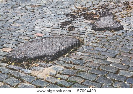 A Road Damaged By Rain And Snow, That Is In Need Of Maintenance. Broken Asphalt Pavement Resulting I