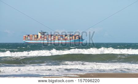 San Francisco CA - November 16 2016: Maersk cargo ship GUSTAV MAERSK entering the San Francisco Bay en route to the Port of Oakland. High tide and heavy surf.
