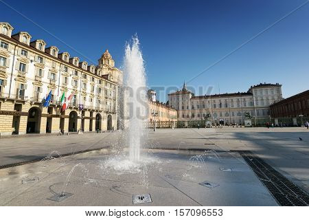TURIN, ITALY - AUGUST 27, 2016: Fountain in Piazza Castello and Royal Palace in the background