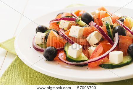 Classic greek salad. Salad with tomato cucumber red onion black olives and fresh feta cheese selective focus horizontal