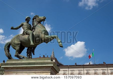 TURIN, ITALY - MAY 27, 2013: The equestrian statue of Castor at the entrance of the Royal Palace