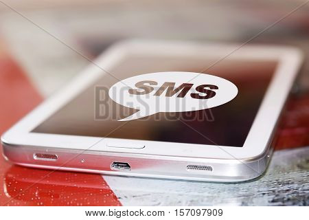The symbol sms on the screen cell phone .
