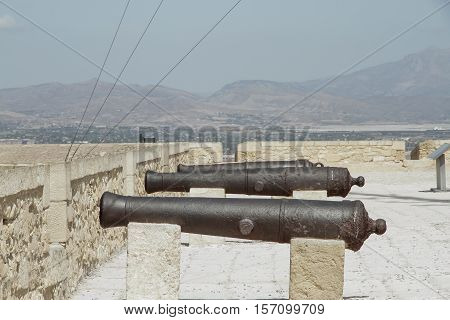 line of ancient cannons in rampart of a fortress
