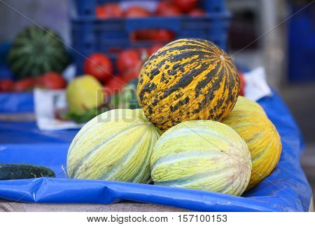 Yellow melons prepared to sell in market.