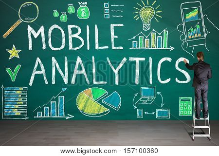 Businessman Drawing Mobile Analytic Concept On Blackboard