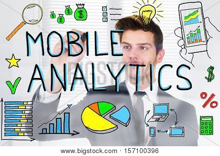 Businessperson Drawing Mobile Analytic Concept On Glass