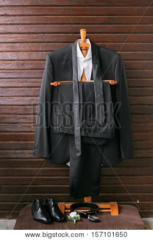 Collection of fashionable business clothes for men. The discreet black suit tie, shirt, leather shoes.