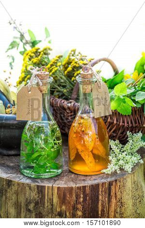 Healthy Tincture With Alcohol And Herbs On Old Wooden Table