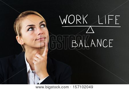 Young Businesswoman Thinking About Balancing Work Life On Black Background