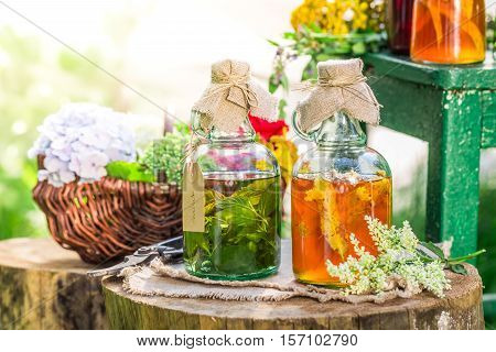 Healing Tincture As Homemade Cure On Old Wooden Table