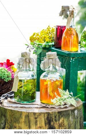 Healing Herbs In Bottles With Alcohol And Herbs